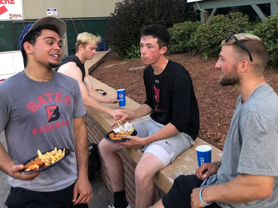Following their July 21 game in Nashua, the four Bates players on the Nashua Silver Knights and Bristol Blues chow down on a post-game meal. From left, Christian Beal '21 (Bristol), Nolan Collins (Nashua), Miles Michaud '20 (Bristol), and Jack Arend '20 (Nashua). (Photograph by Peggy Arend)