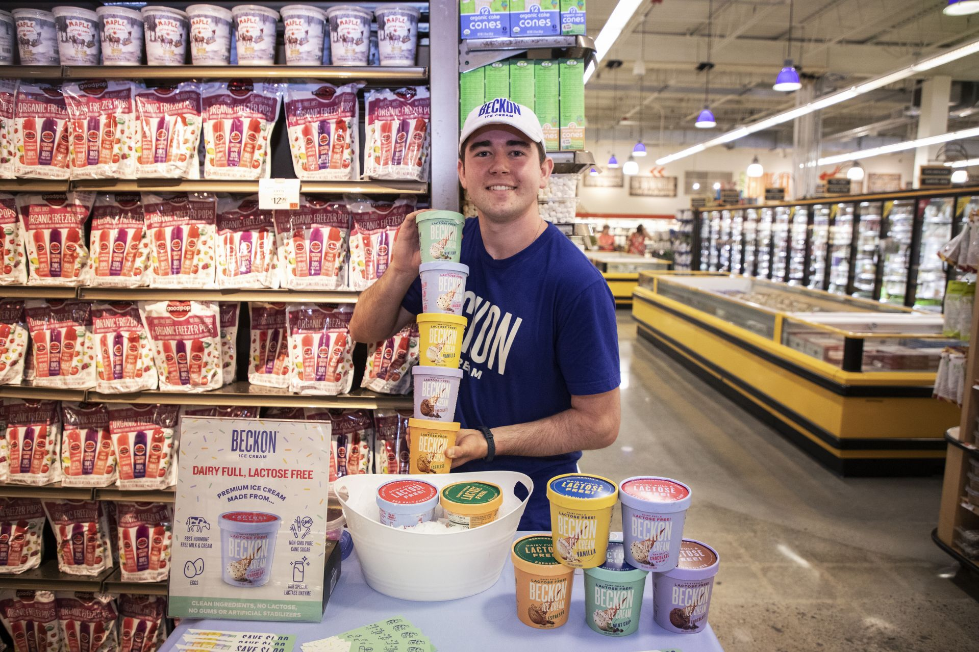 James MacDonald '20 of Quincy, Mass., economics major, mathematics minor, displays some of the Beckon Ice Cream flavor options as he prepares a demo at the Whole Foods South Weymouth location on July 22, 2019.