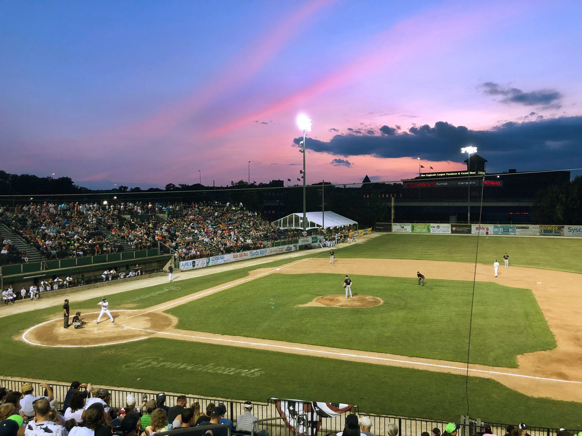Before a big crowd at Nashua's historic Holman Stadium on Aug. 2, Nolan Collins '20 delivers a pitch to batterymate Jack Arend '20 as the Silver Knights take on Worcester in Futures League action on Aug. 2. (Photograph by Peggy Arend)