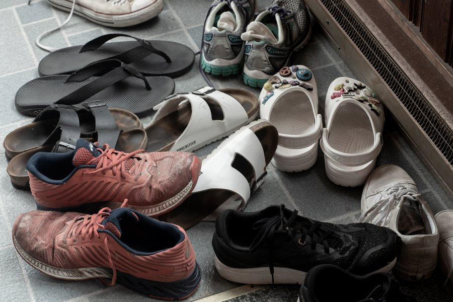 """The gathering of shoes"": Generations of family and friends visiting Jean and Bill Holt in Ocean Park leave their footwear at the door. (Phyllis Graber Jensen/Bates College)"