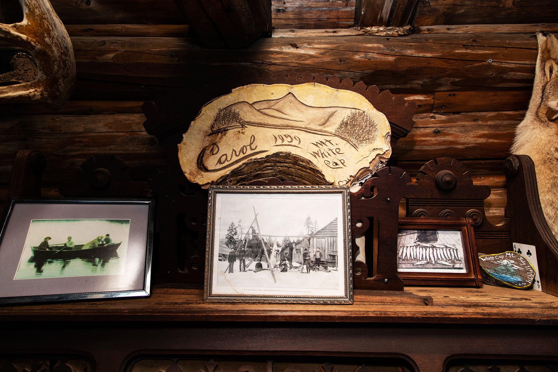 Vintage photos and memorabilia on display in the West Branch Pond Camps dining hall. (Theophil Syslo/Bates College)