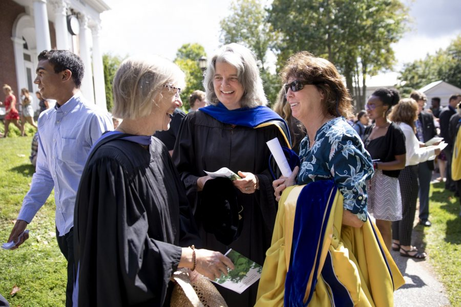 After Convocation, Costlow takes a moment to catch up with friends Beverly Johnson, professor of geology, and Lynne Lewis, Elmer W. Campbell Professor of Economics. (Phyllis Graber Jensen/Bates College)
