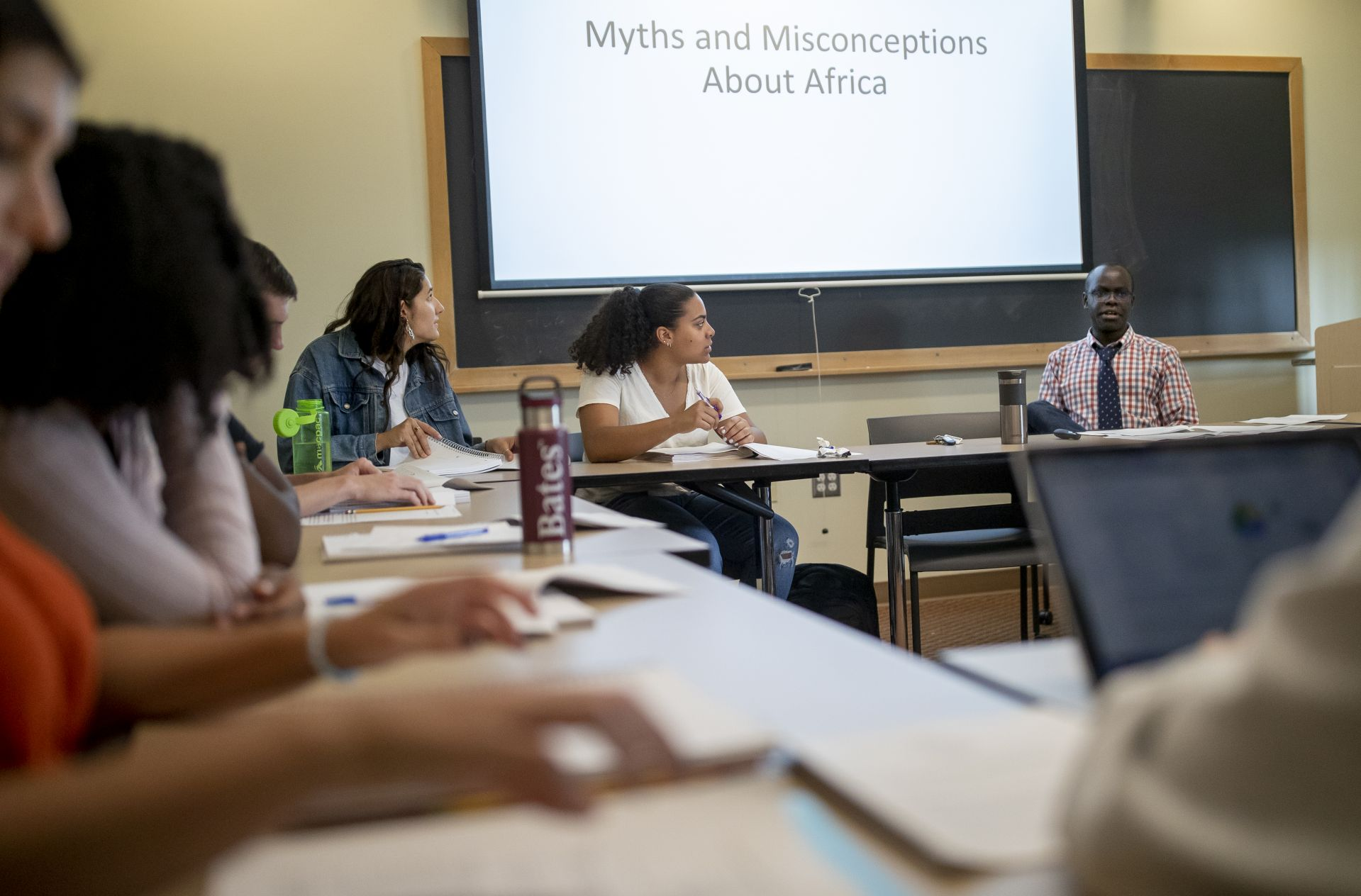 """First day of classes in the fall semester's first day, Assistant Professor of History Patrick Otim meets with students in his First Year Seminar, """"Beyond Nelson Mandela: Themes and Personalities in South African History"""