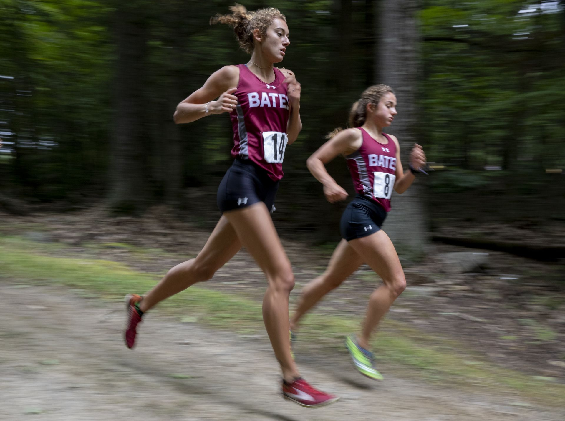 Elise Lambert '22 (left) of Amherst, N.H., and Lily Harding '23 of Kenfield, Calif., navigate the 5K course during the Bates Invitational cross country meet at Pineland Farms in nearby Gray, a tuneup for October's Maine State Meet, which the Bobcats have won three straight years. (Phyllis Graber Jensen/Bates College)
