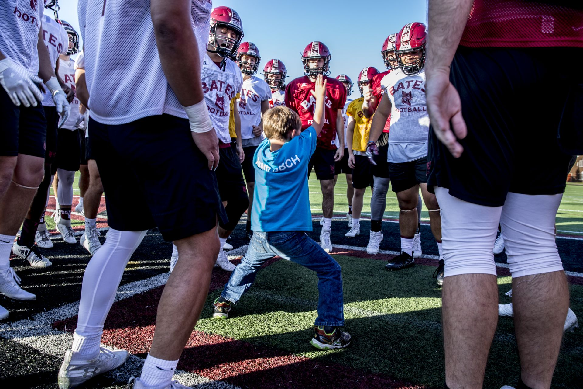 During its Sept. 19, 2019 practice, honorary team captain, Brayden Austin, 6, of Sabbatus, joins the team on the field. (Phyllis Graber Jensen/Bates College)