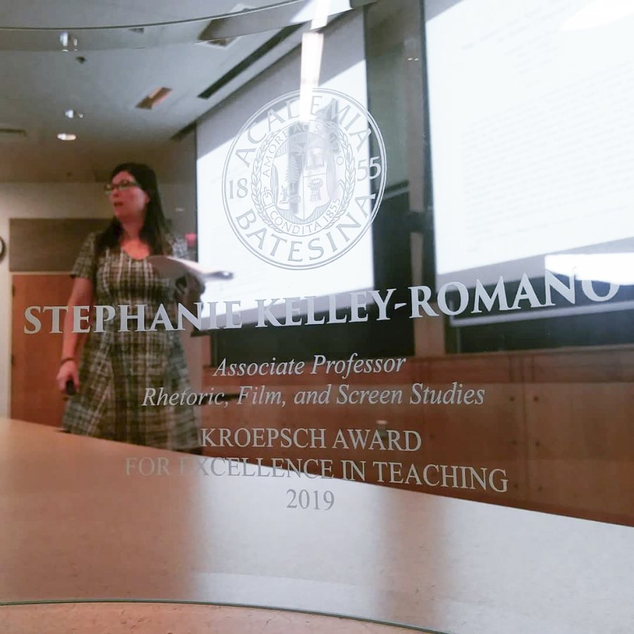 Stephanie Kelley-Romano as seen through her transparent Kroepsch Award. (Photograph by Jonathan Cavallero)