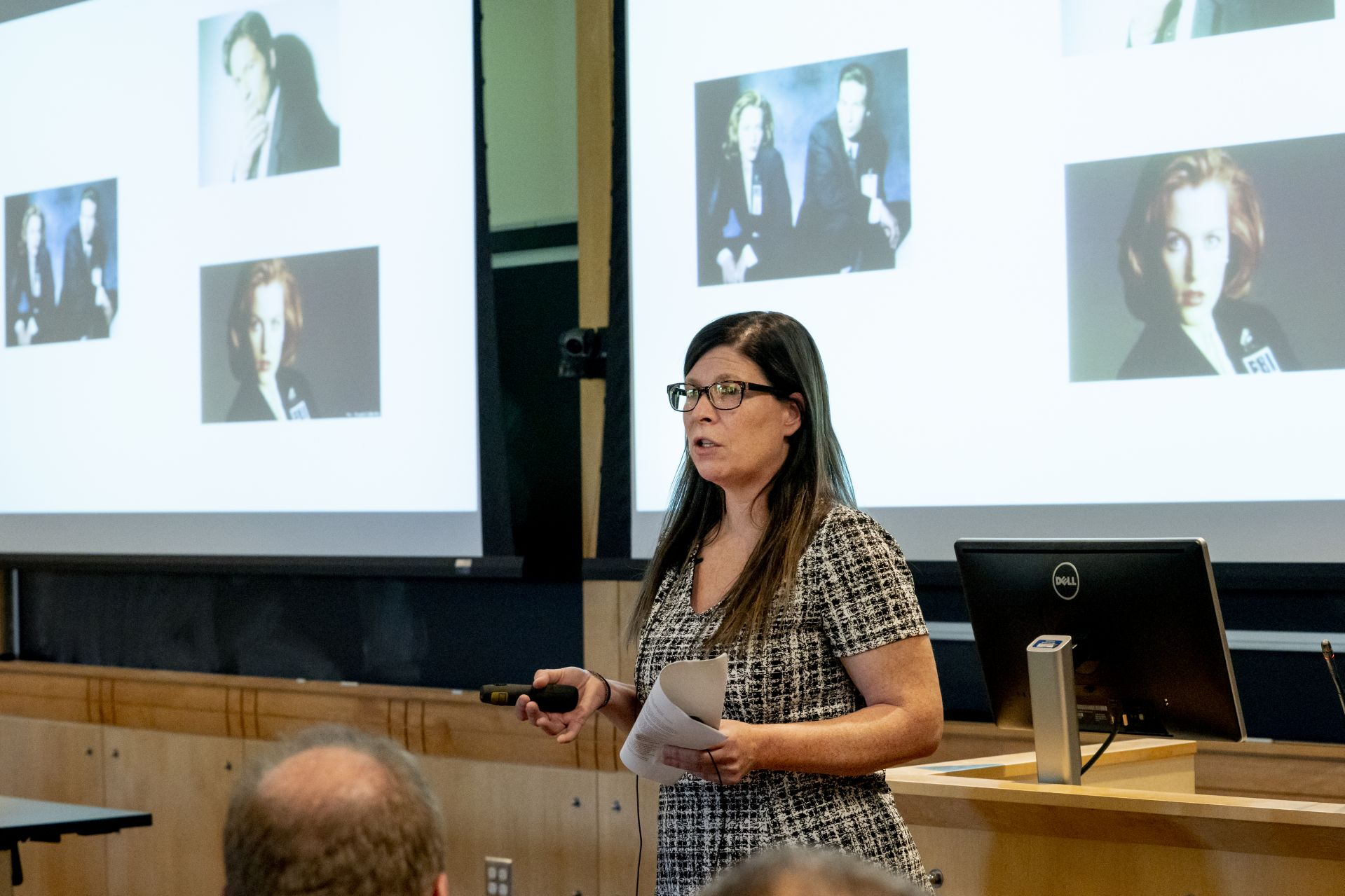 """This place has changed my life and it will change yours...Now, let's talk about conspiracy theories and aliens!"". After receiving her 2019 Ruth M. and Robert H. Kroepsch Award for Excellence in Teaching, Associate Professor of Rhetoric, Film, and Screen Studies Stephanie Kelley-Romano kicked off the 2019 Kroepsch Lecture on Sept. 19 with her characteristic warmth and wit. . Praised as a teacher who's exacting, empathetic, authentic — and passionate about her field, Kelley-Romano is known at Bates and beyond for her professional focus on topics in the popular consciousness — the rhetoric of television, conspiracy theories, and abductions by space aliens, to name a few. Her biennial course on presidential campaign rhetoric is built around a mock campaign that affords an intensely hands-on, multidisciplinary experience for students. . The award honors faculty for their outstanding performance as teachers. Each year a committee of previous recipients selects the Kroepsch honoree from a list of nominations by students. An endowment established in 1985 by Robert Kroepsch '33 funds the endowment."