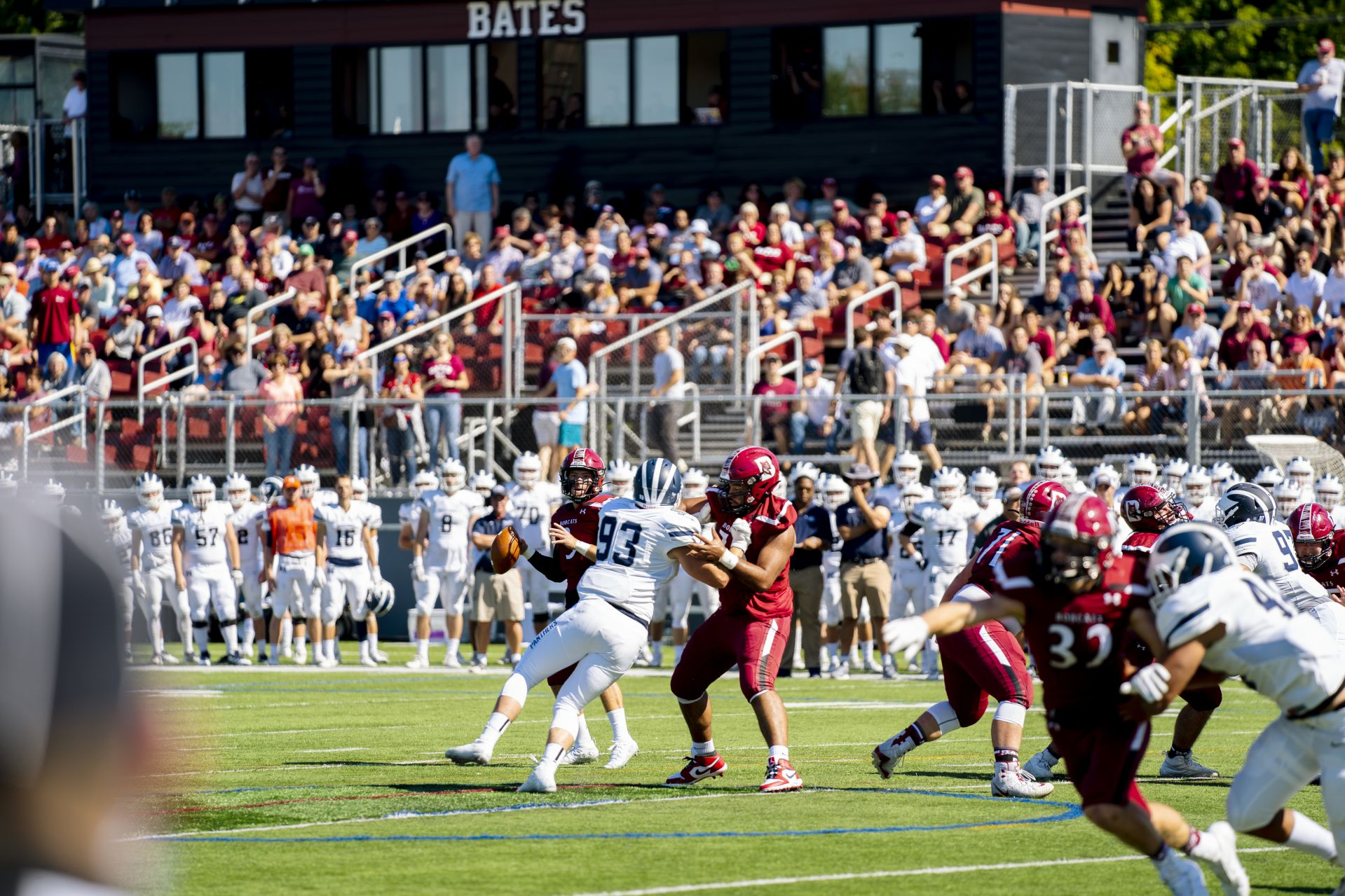 Quarterback Brendan Costa '21 of Westport, Mass., looks to pass during the Bobcats' home opener vs. Middlebury at Garcelon Field. (Theophil Syslo/Bates College)