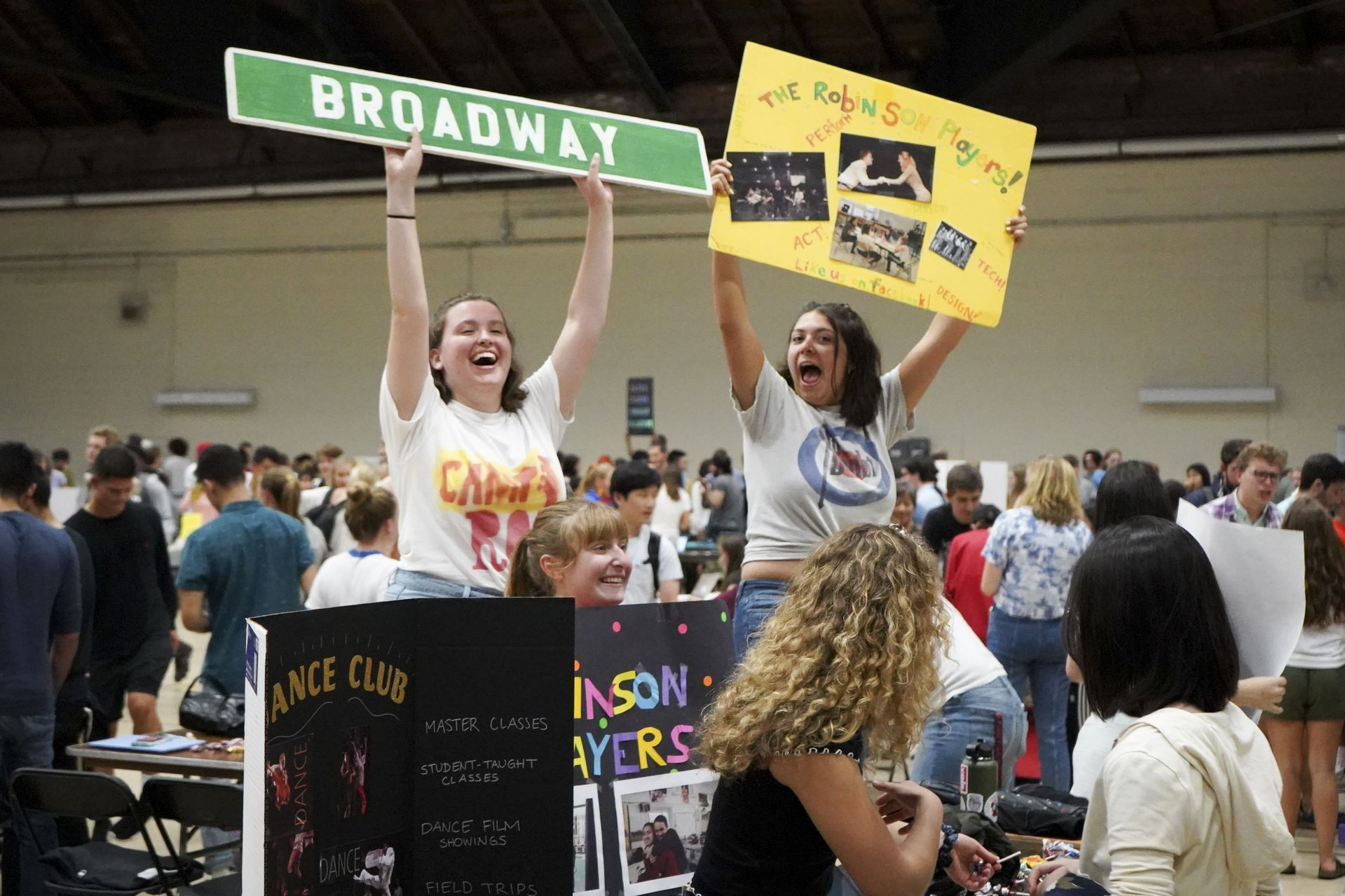 Enthusiastic members of the college's student theater club, the Robinson Players, participate in an annual fair in the Gray Athletic Building where members of the college's 80-plus clubs outdo one another to attract new members. (Samuel Mironko '21 for Bates College)