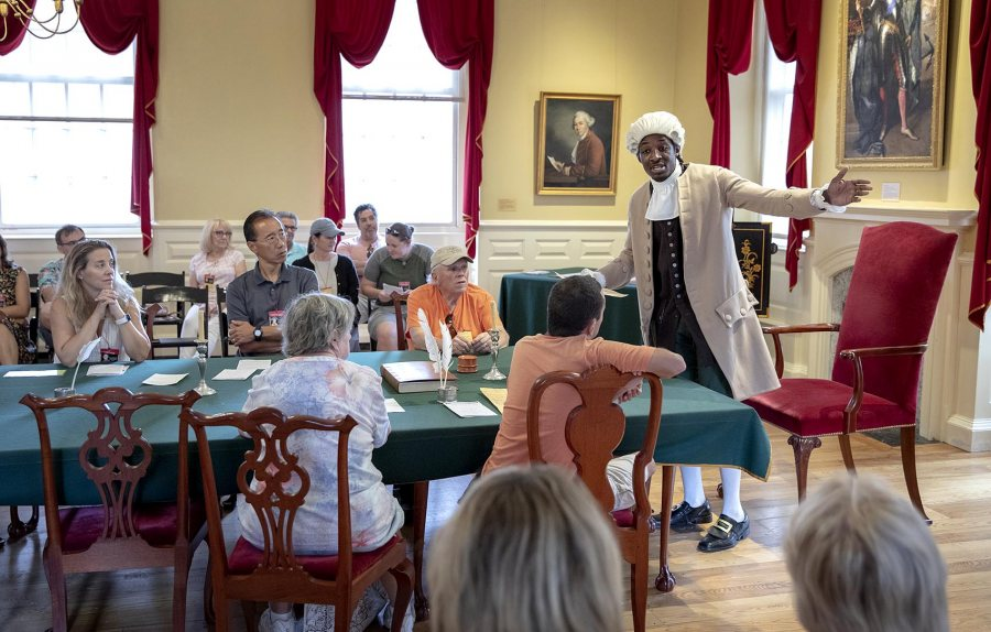 """Stephen Sampson plays Prince Hall at a performance of """"The Petition"""" at the Old State House. (Robin Lubbock/WBUR)"""