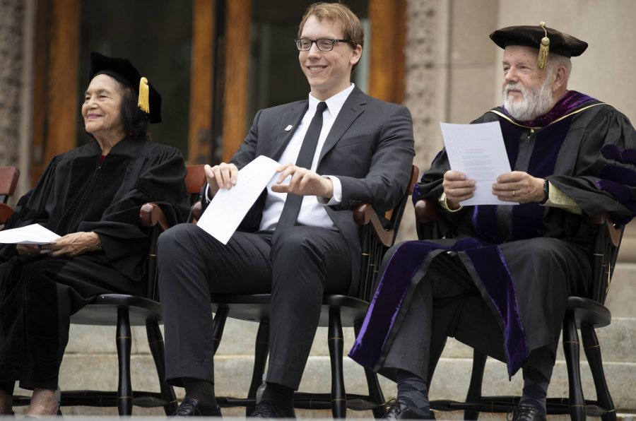 At Opening Convocation on Sept. 3, Ryan Lizanecz '20 (center) sits between keynote speaker and honorand Dolores Huerta and Phillips Professor of Economics Michael Murray. (Phyllis Graber Jensen/Bates College)