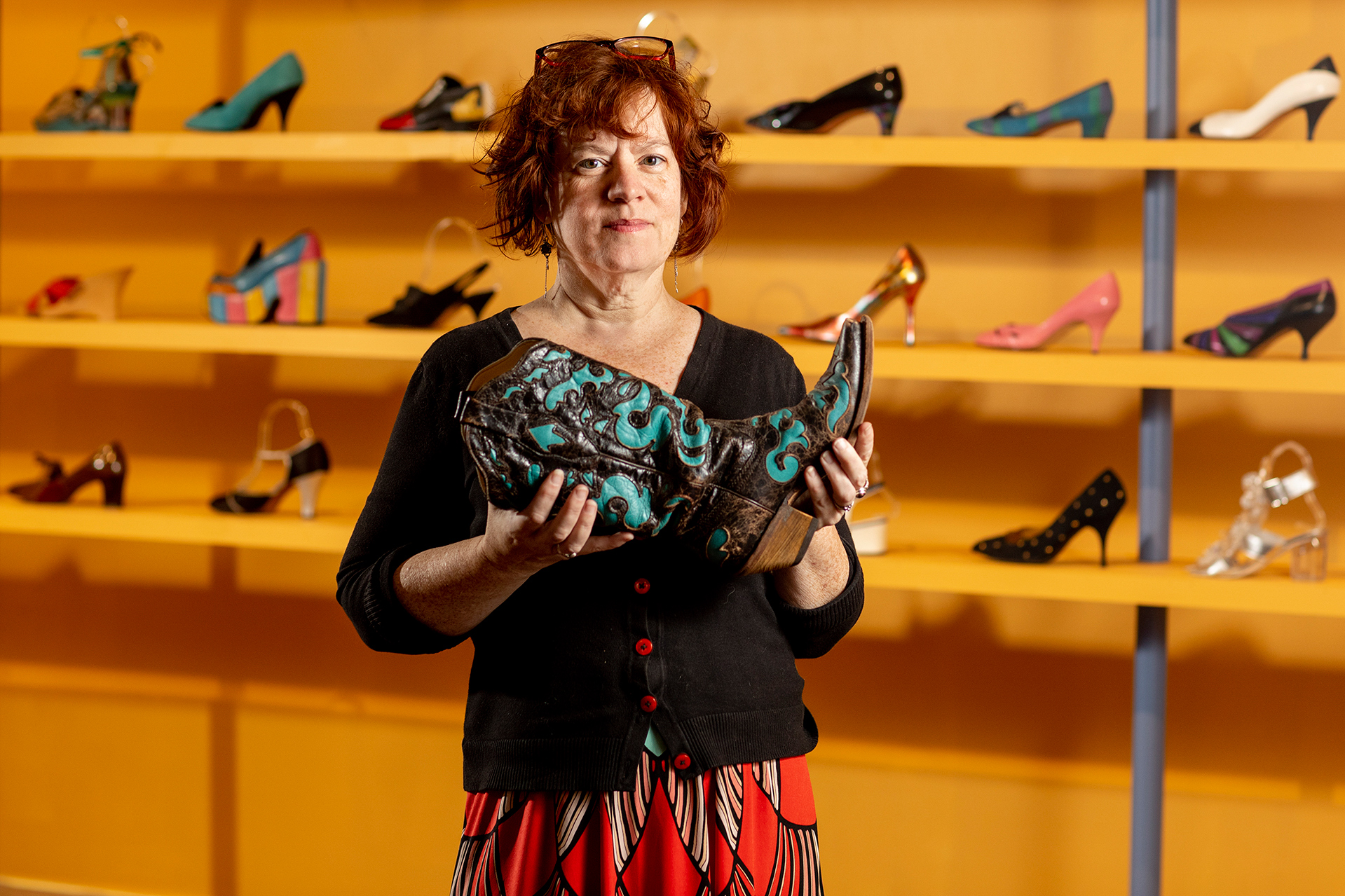 "Associate Professor of Theater Christine McDowell's has curated Museum L-A 's shoe exhibition.Museum L-A's gallery is filled to the brim with shoes for its newest exhibit ""Footwear: From Function to Fashion."" The exhibit explores the whimsy and artfulness that shoe designs have played with for decades to acknowledge that shoes, while primarily used as an often-forgotten functional item, can be masterpieces in their own right. A certain focus is placed on the extensive history of the shoe industry in Auburn, once the fifth largest producer of footwear in the country, through a timeline representing the ebb and flow of the local companies historically making shoes in our community. This exhibit is Museum L-A's next step in the progression of telling this industry's story – this time focusing on the product that was being created by the millions right in our little corner of Maine while also creating an opportunity to celebrate the 150th Anniversary of the City of Auburn, 1869-2019."
