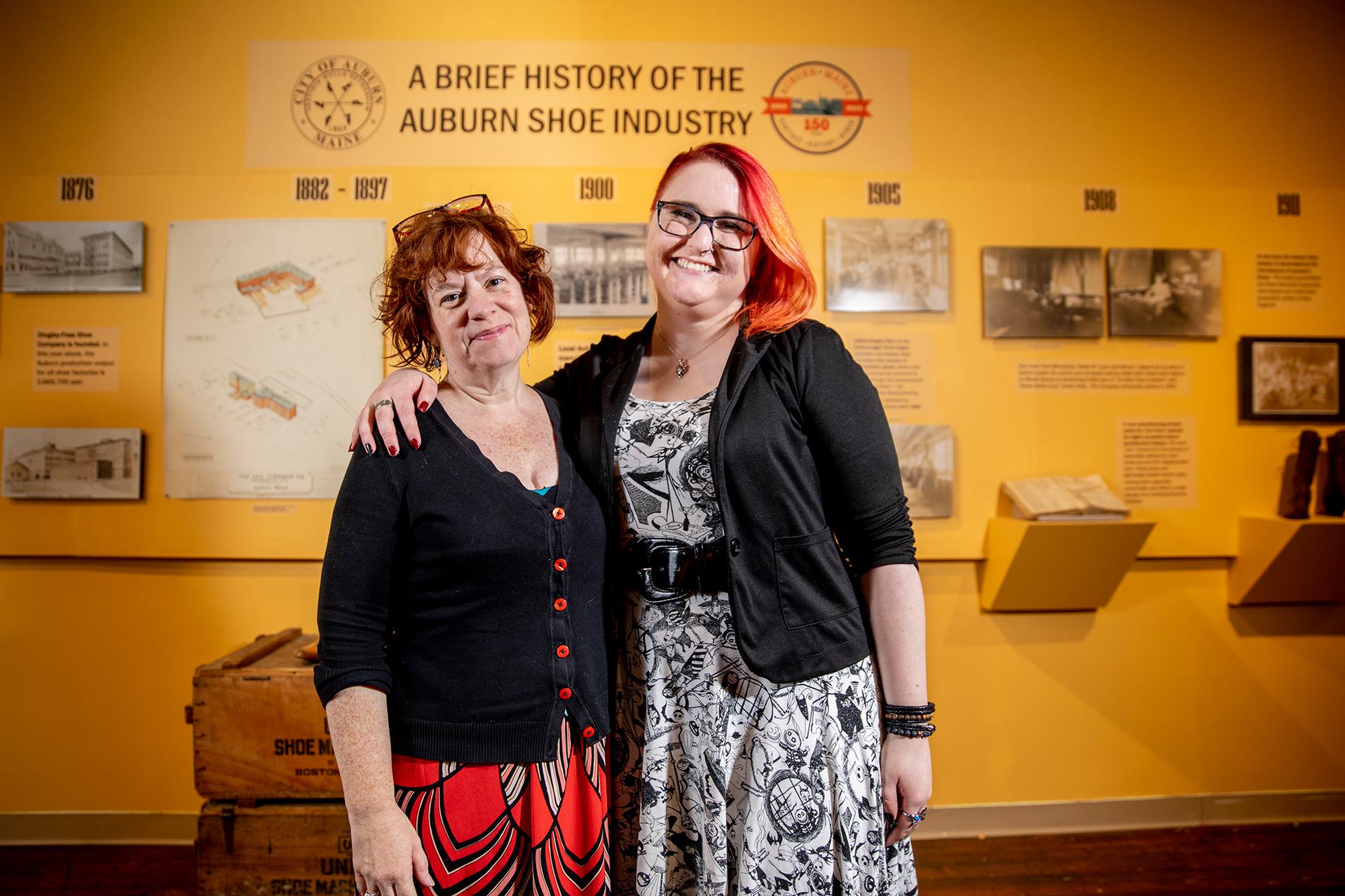 Associate Professor of Theater Christine McDowell, left, worked with Emma Sieh, Museum L-A collections and exhibits coordinator, to create the museum's shoe exhibition. (Phyllis Graber Jensen/Bates College)