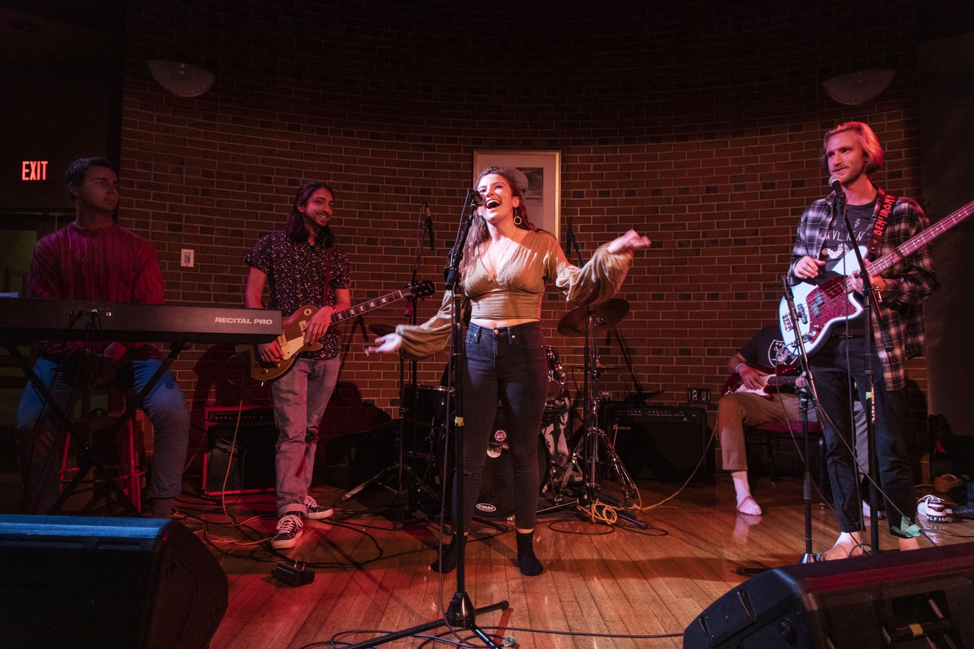 Surrounded by bandmates, Becca Kraft of Newton Center, Mass.,