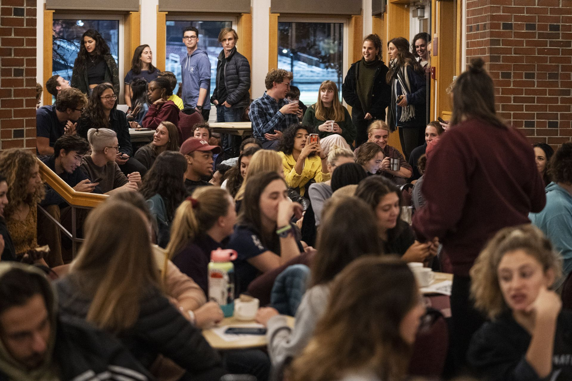It's standing room only for the Village Club Series' Student Showcase event on Oct. 10. (Theophil Syslo/Bates College)