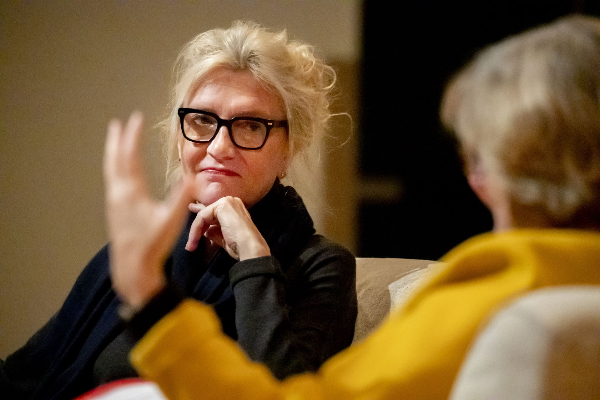 """Bestselling author Elizabeth Strout '77 says good night to Hermione Zhou '21 of Shenzhen, China, after signing Zhou's copy of """"Olive, Again"""" (Random House 2019), Strout's latest novel. A sequel to the Pulizer Prize-winning """"Olive Kitteridge,"""" """"Olive, Again"""" revisits an unforgettable cast of characters in fictional Crosby, Maine. Strout participated in a reading and conversation with Bates President Clayton Spencer, then signed books and spoke with a long line of admirers. Among Strout's family and friends in attendance was Governor of Maine Janet Mills."""