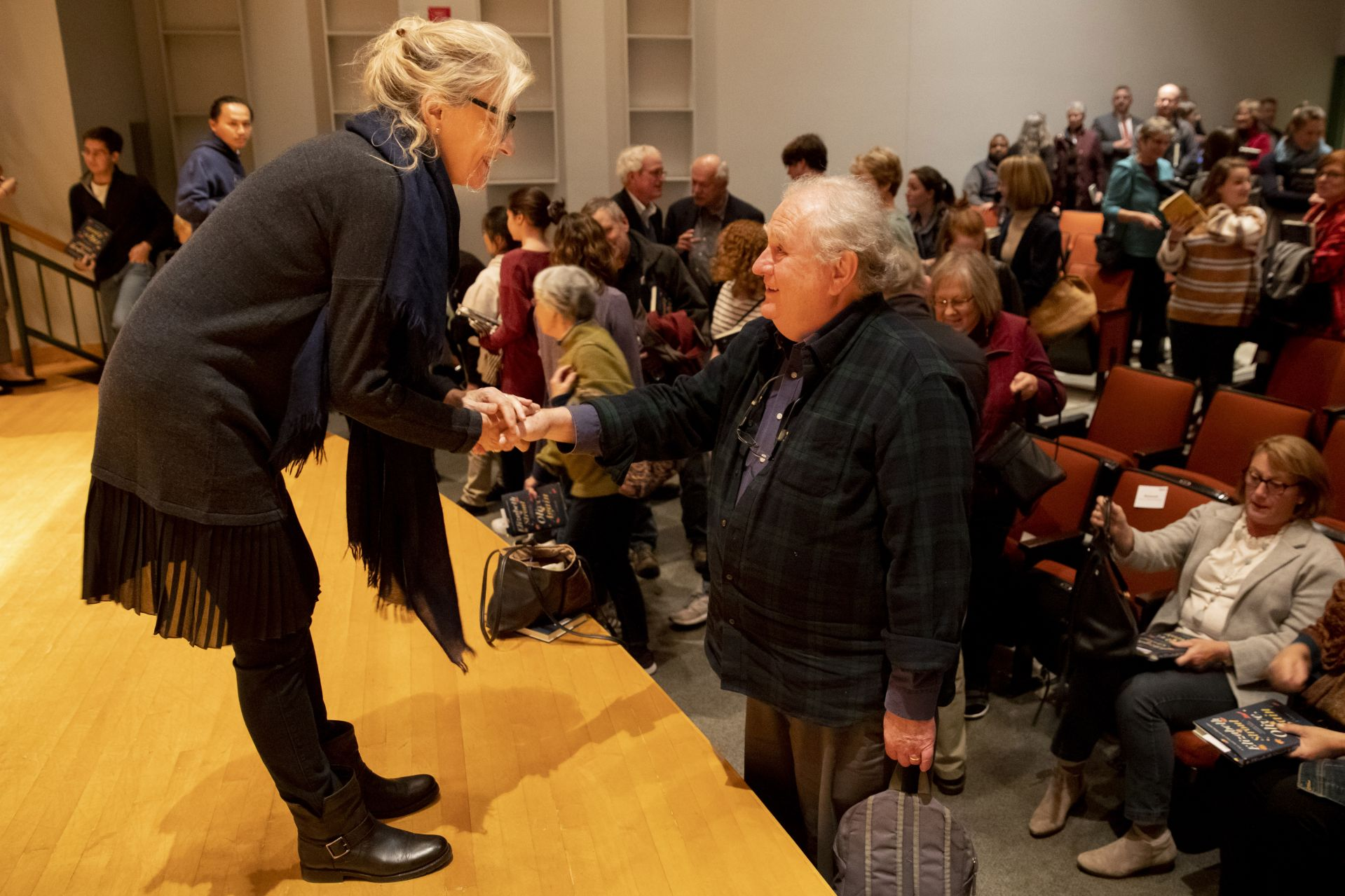 Elizabeth Strout '77 greets Dana Professor of Theater Martin Andrucki, one of her formative Bates professors, following her talk in the Olin Arts Center Concert Hall on Oct. 21. (Phyllis Graber Jensen/Bates College)