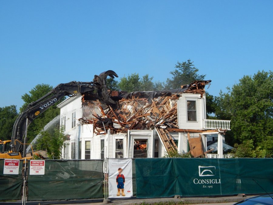 Tearing down 75 Campus Ave., once the home of Bates' religion and philosophy faculties, to make way for Kalperis Hall on Aug. 5, 2014. (Doug Hubley/Bates College)