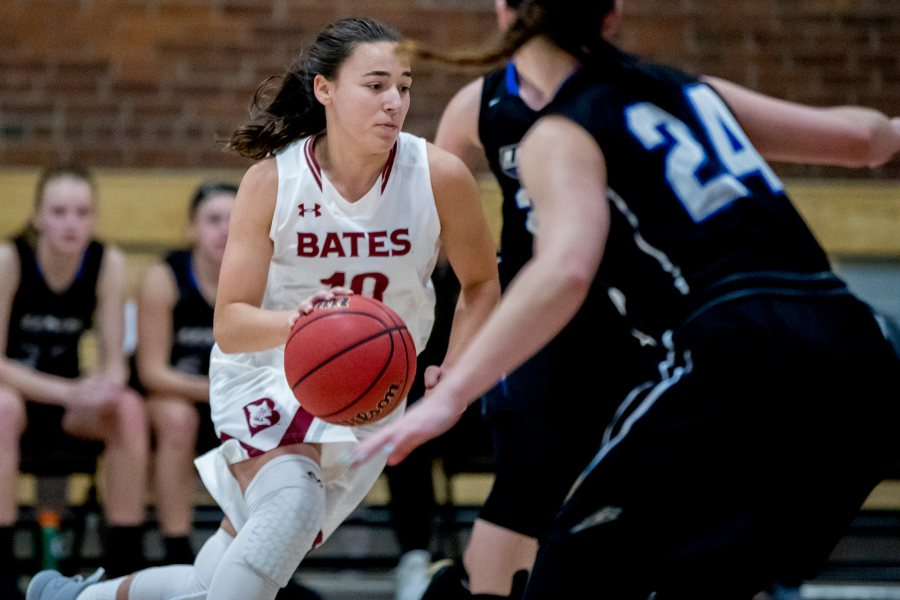 The Bates women's basketball team hosts four games in December, including a Dec. 7 context against St. Joseph's. Seen here against the University of New England last year is Melanie Binkhorst '20, who recorded 11 points, six rebounds, one assist and three steals in Bates' 86-85 on Nov. 25. (Phyllis Graber Jensen/Bates College)