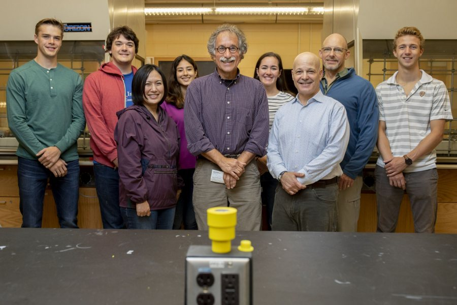 Dana Professor of Chemistry Tom Wenzel (center) is flanked by donors Jim Weissman '84 and Kyoko Weissman as they celebrate the establishment in September of the Thomas J. Wenzel Endowed Fund for Undergraduate Chemistry Research. Joining them in Dana Chemistry Hall are, from left, Jake O'Hara '21, Nick Jones '20, Shanzeh Rauf '21, Maddie Murphy '20, Associate Professor of Chemistry Matt Côté, and Owen Bailey '22. (Phyllis Graber Jensen/Bates College)