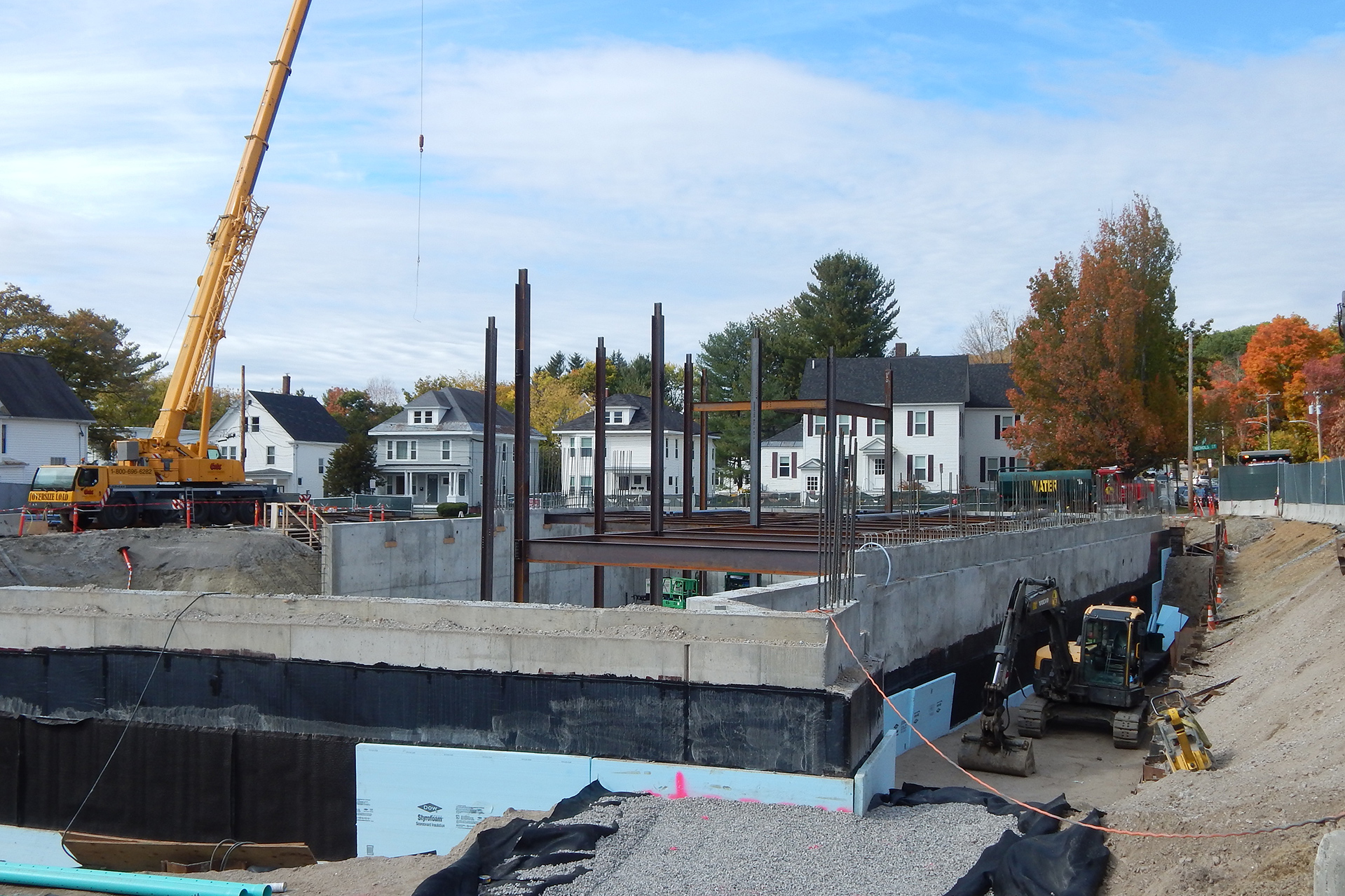 The state of steel at the Bonney Science Center on Oct. 11, 2019. At left, note the gap in the foundation wall where the areaway will be built. At right, note the wide trench and exposed foundation: This area will be backfilled once the first-floor slab is placed, which will reinforce the foundation sufficient to withstand the external pressure from additional tons of dirt. (Doug Hubley/Bates College)