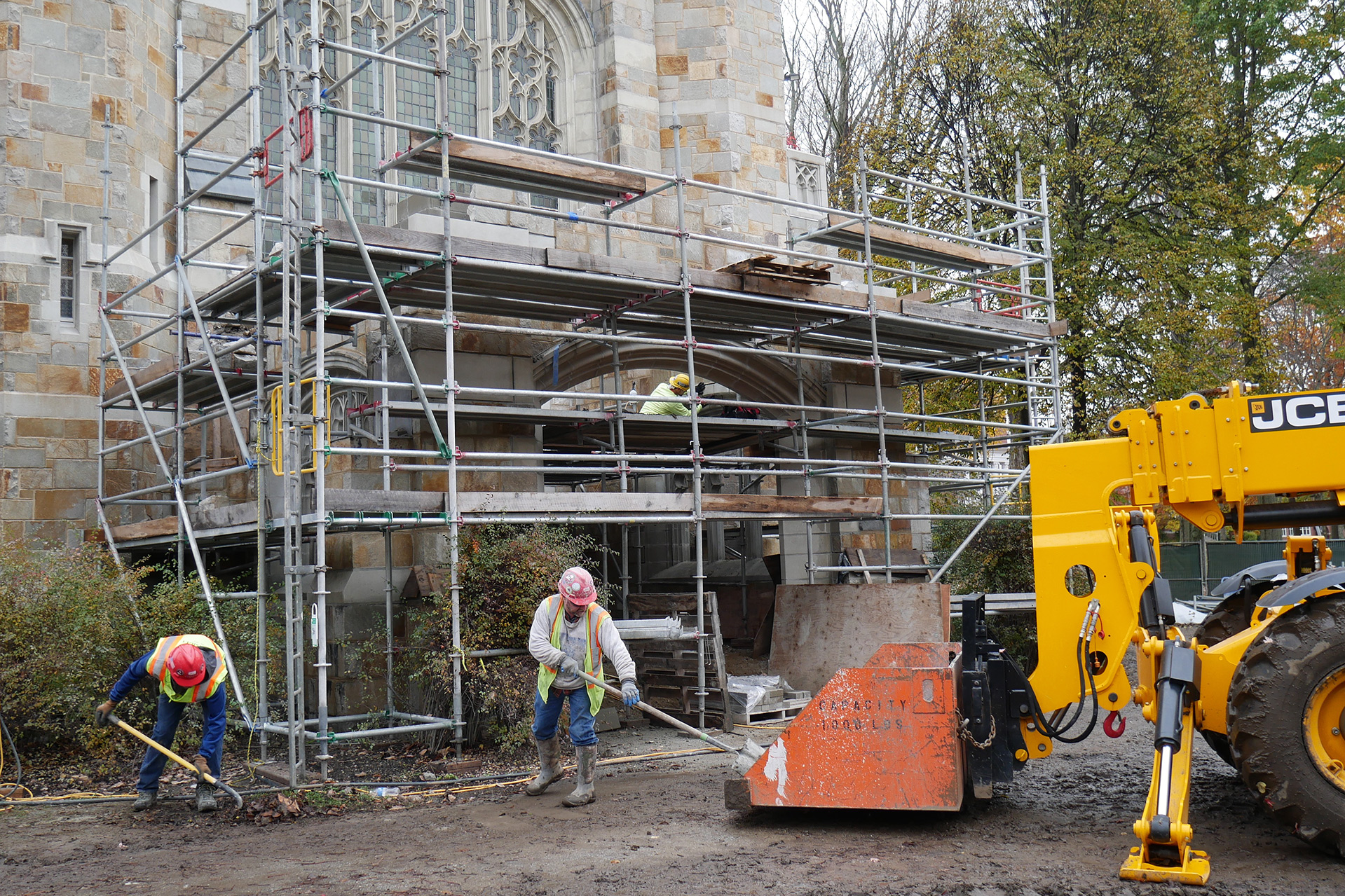 Cleaning up around the Gomes Chapel portico on Oct. 30, 2019. Note the new arch at center -- much of the exterior masonry on the portico has been renewed. The floor and roof will be replaced next spring or summer. (Doug Hubley/Bates College)