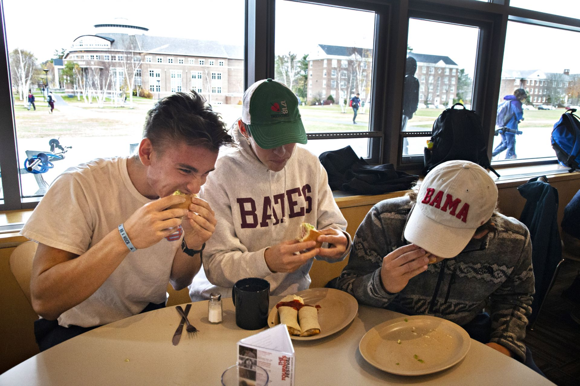 Robert Sobolewski '22 of Chevy Chase, Maryland, Nick Van Ingen '23 of Darien Conn., and William Bolin '23 of Monkton, Maryland., share and eat a Bobcat sandwich while at Commons on November 7, 2019.