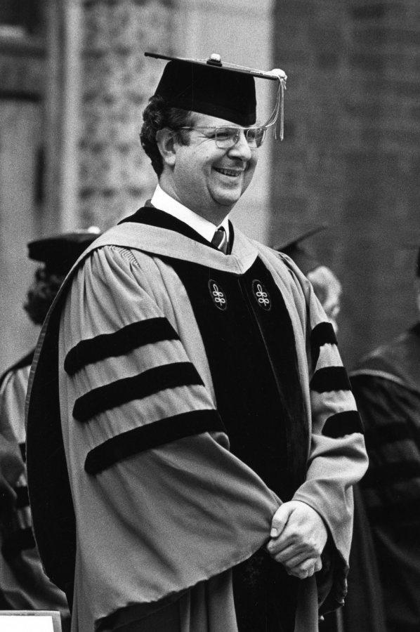 Carl Straub stands during the processional of Commencement in 1977. (Muskie Archives and Special Collections LIbrary)