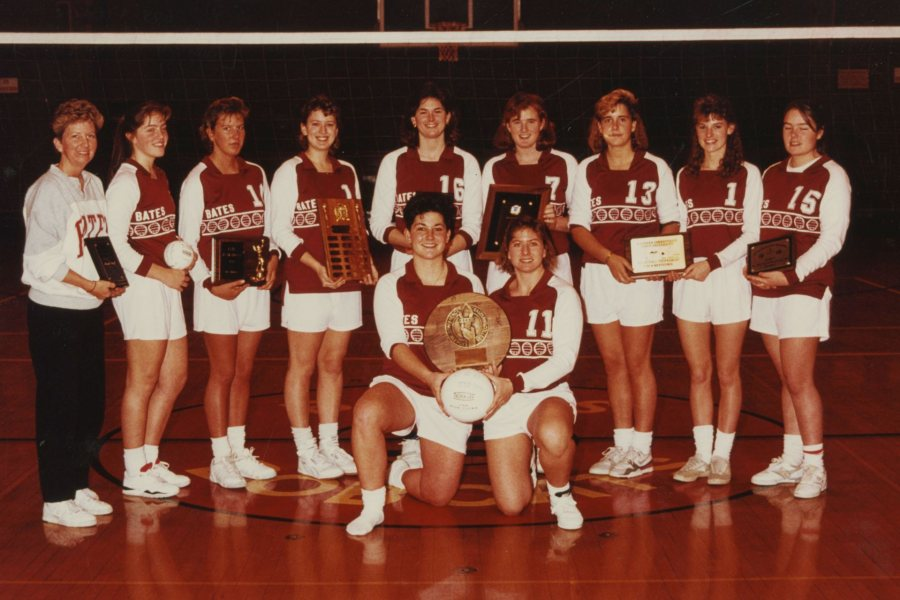 The Bates volleyball team with the ECAC Championship trophy. Back row from left to right: Marsha Graef, Cindy Simonides Farina '93, Jennifer White Campbell '91, Laurie Plante Graumann '90, Rachel Clayton '90, Julie Roche Simplicio '91, Andrea Corradini '92, Allyson Reynolds Wachtel '93, Nicole Bolduc Schmidt '90. Front row from left to right: Michele Feroah '90, Cathy Meoni Ringling '90.