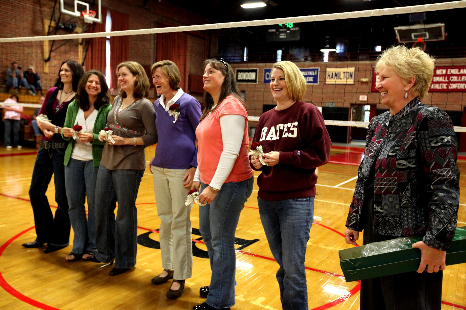In 2009, members of the undefeated 1989 volleyball team and their coach, Marsha Graef (right), enjoyed a recognition ceremony in Alumni Gym during Homecoming Weekend. From left, Rachel Clayton '90, Cathy Meoni Ringling '90, Laurie Plante Graumann '90, Julie Roche Simplicio '91, Cindy Simonides Farina '93, Allyson Reynolds Wachtel '93, and Graef. (Phyllis Graber Jensen/Bates College)