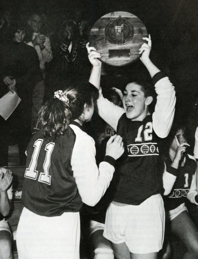 Co-captains Michele Feroah (right) and Cathy Meoni celebrate Bates' victory in the 1989 ECAC championship match, capping a 36-0 season. (Bates Communications)