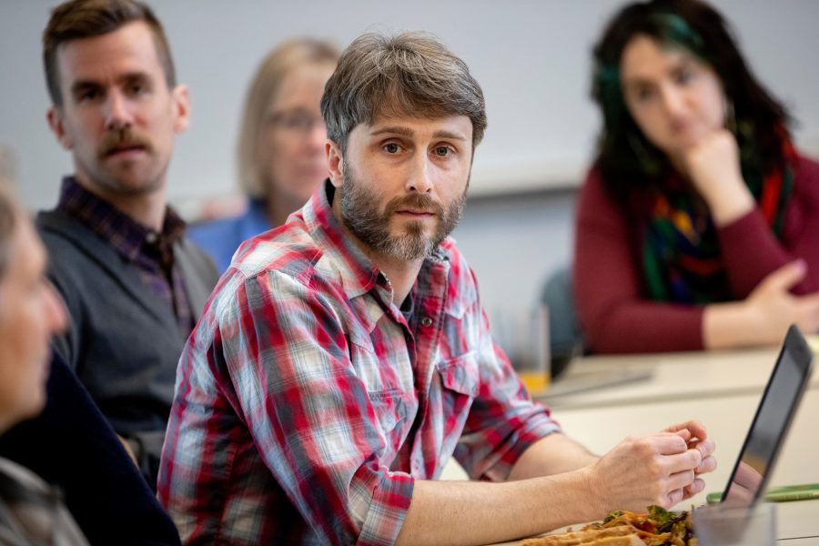 Travis Gould is chair of both the physics department and the college's Committee on Environmental Responsibility. He is shown in that role during a meeting last May that confirmed that Bates had attained carbon neutrality. (Phyllis Graber Jensen/Bates College)