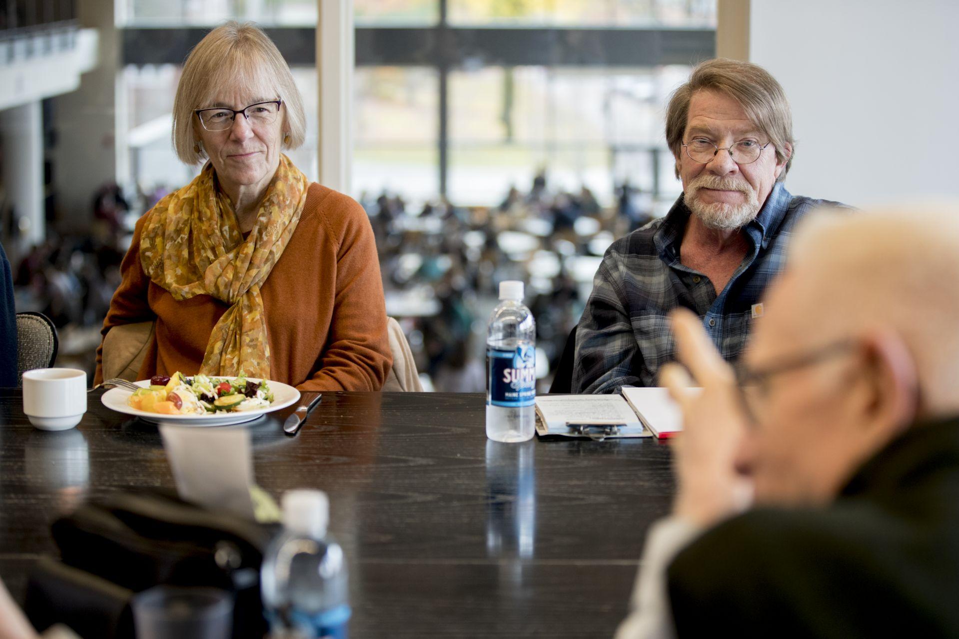 Costlow and Senior Lecturer Emeritus in English Rob Farnsworth listens as Professor Emeritus of Anthropology Charles Carnegie speaks during an emeriti luncheon. (Phyllis Graber Jensen/Bates College)