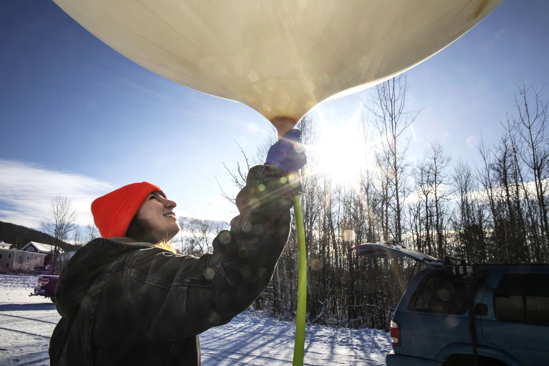 "Madison ""Maddie"" Hallowell '19 of North Haven, Maine, Interdisciplinary Studies,High Altitude Ballooning Club leader, fills a ballon with helium on November 9, 2019."