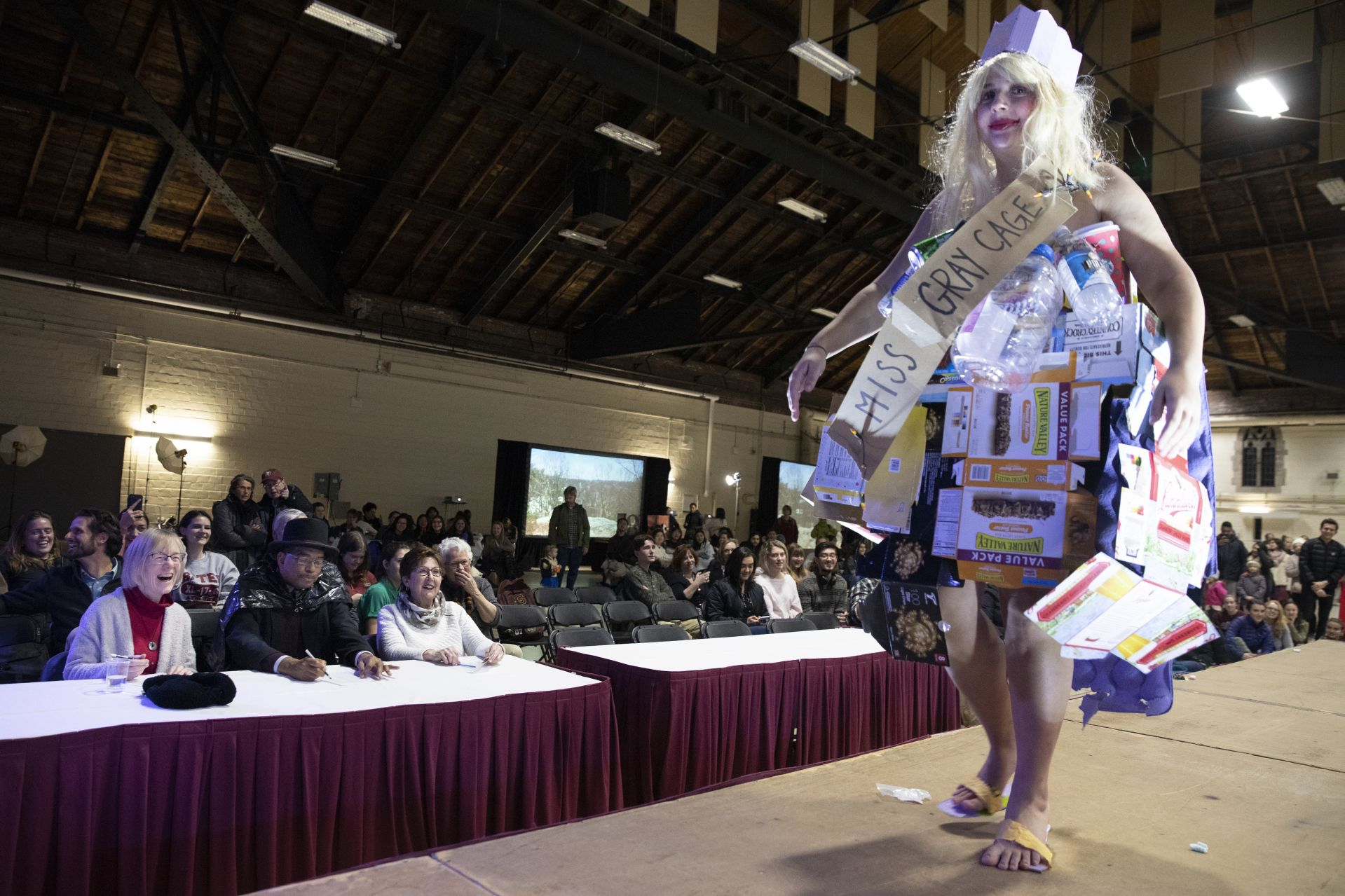 Costlow, James Reese, and Flo Laflamme, judges at this year's Trashion Show, react to a walk down the runway by model Eden Rickolt '20 of Landenberg, Pa.(Phyllis Graber Jensen/Bates College)