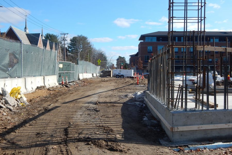 Part of November's progress at the Bonney Science Center was backfilling that buried the foundation walls, as well as the steel sheet piling that kept the foundation hole open early in the construction process. The white trailer is a space heater. (Doug Hubley/Bates College)