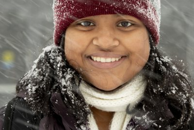 """My hat? It's the only one I own."".— Arya Mohanty '23 of Winchester, Mass., poses for a quick portrait in the snow on her way to lunch in Commons."