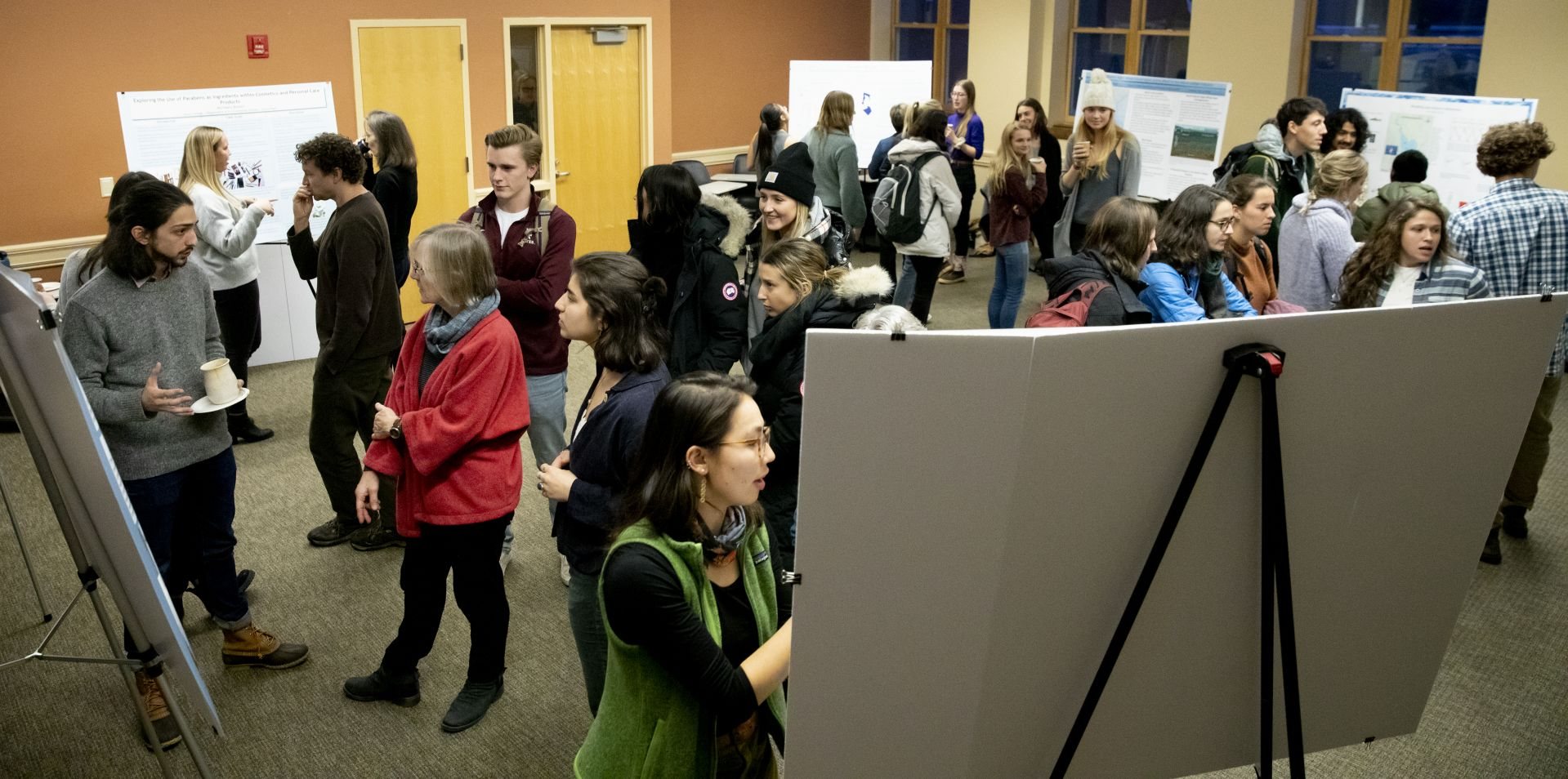 In a Hedge Hall classroom filled with environmental studies posters, Costlow speaks with Tanner Stallbaumer '20 of New York City about his research on early effects of Russian influence in the Aral Sea Basin. (Phyllis Graber Jensen/Bates College)