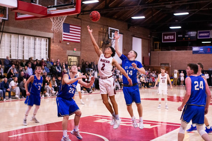 Men's basketball resumes for the new year on Jan. 2. Shown on Dec. 7 is Stephon Baxter of Worcester, Mass., during the Bobcats' 84-69 victory over St. Joseph's College of Maine. Baxter scored a team-high 15 points during the game. (Theophil Syslo/Bates College)