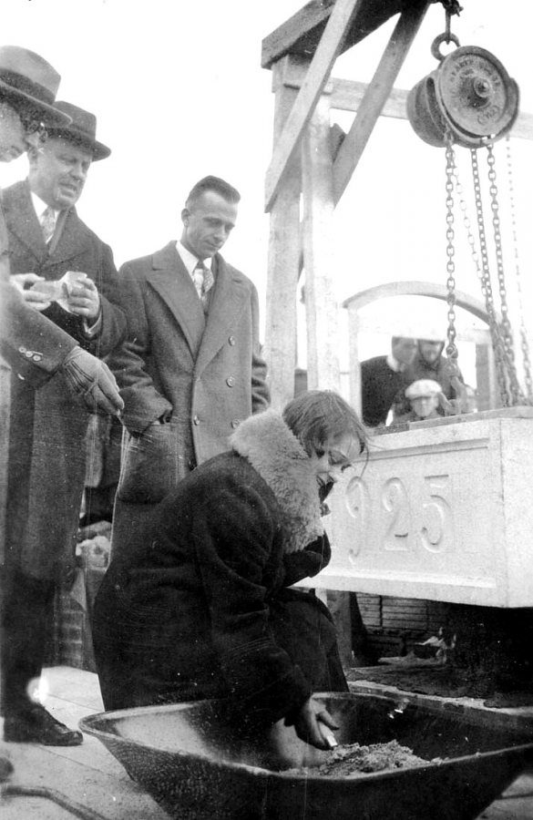 This is likely Elizabeth Stickney '26, senior class vice president, using a trowel to place mortar during the laying the cornerstone for the Gray Athletic Building on Dec. 14, 1925. (Muskie Archives and Special Collections Library)