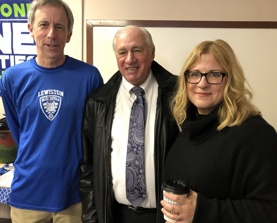 Amy Bass '92 (right) poses with attends a meet-and-greet at the Maine Immigrant and Refugee Services offices during her visit to Lewiston and Bates to promote her book One Goal. In some photos are Kim Wettlaufer '80 (blue longsleeve shirt) Shobow Saban, one of the key figures in her book, wears a dark blue sportcoat with no tie.