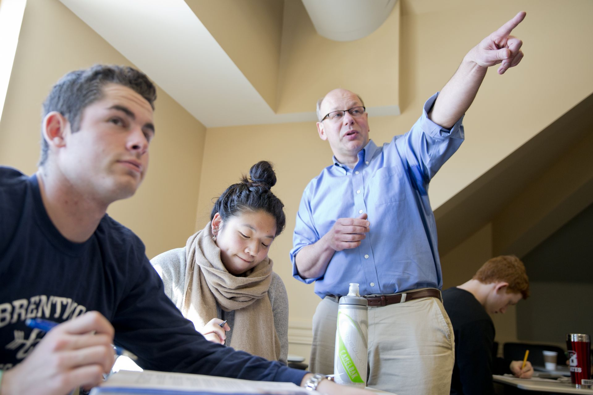 Professor of French and Francophone Studies Alexandre Dauge-Roth, right,  teaches a class in 2015. That year, the relationship between Bates and ILAP began  when Dauge-Roth invited an ILAP leader to speak to his class. (Phyllis Graber Jensen/Bates College)