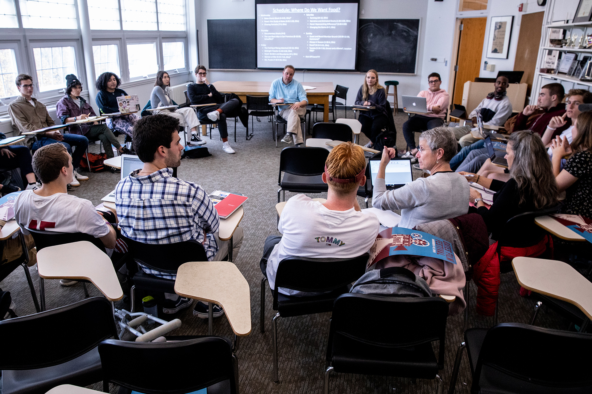 Film and screen studies professor Jon Cavallero and students in his 'Film Festival Studies' course meet with Dining, Conferences, and Campus events staff (center right) for festioval planning in October 2019. (Phyllis Graber Jensen/Bates College)