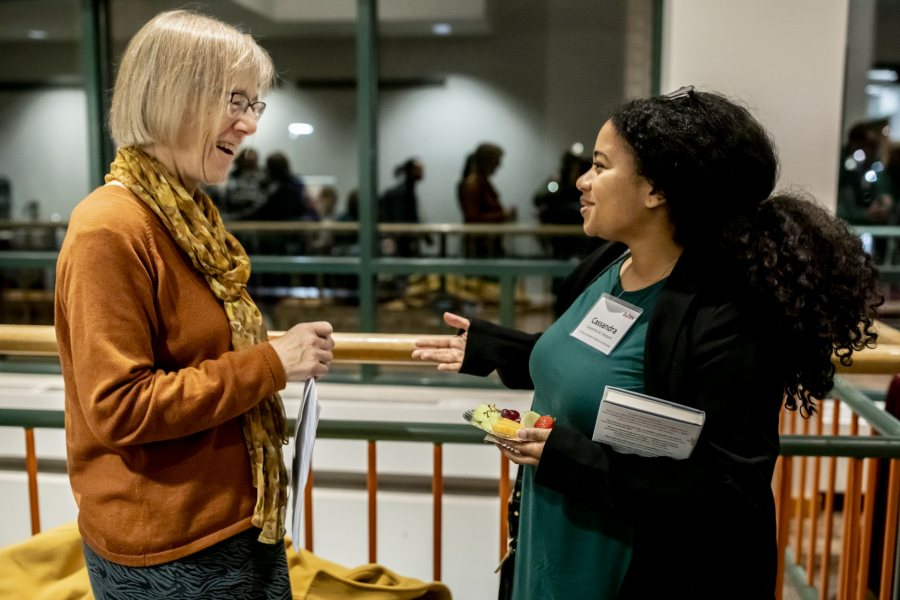 Costlow greets Visiting Assistant Professor of Africana Cassandra Shepard after the Otis talk in November. They have discovered their mutual research and teaching interests in disaster. Shepard teaches about Katrina, Costlow about Chernobyl. (Phyllis Graber Jensen/Bates College)