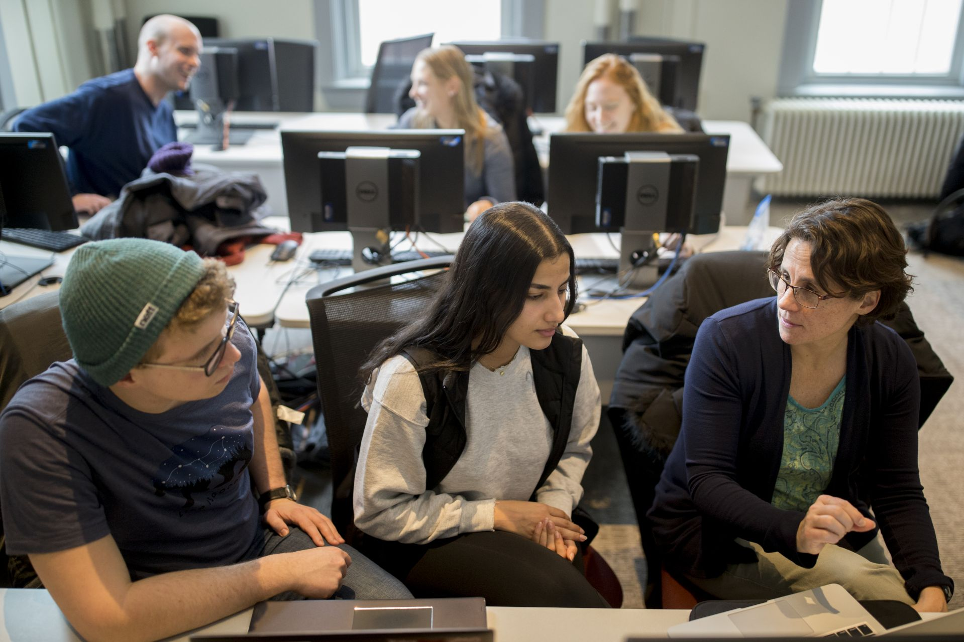 "Meredith Greer and students in a Hathorn Hall classroom during a January meeting of Greer's course ""Advanced Topics in Biomathematics."" (Phyllis Graber Jensen/Bates College)"
