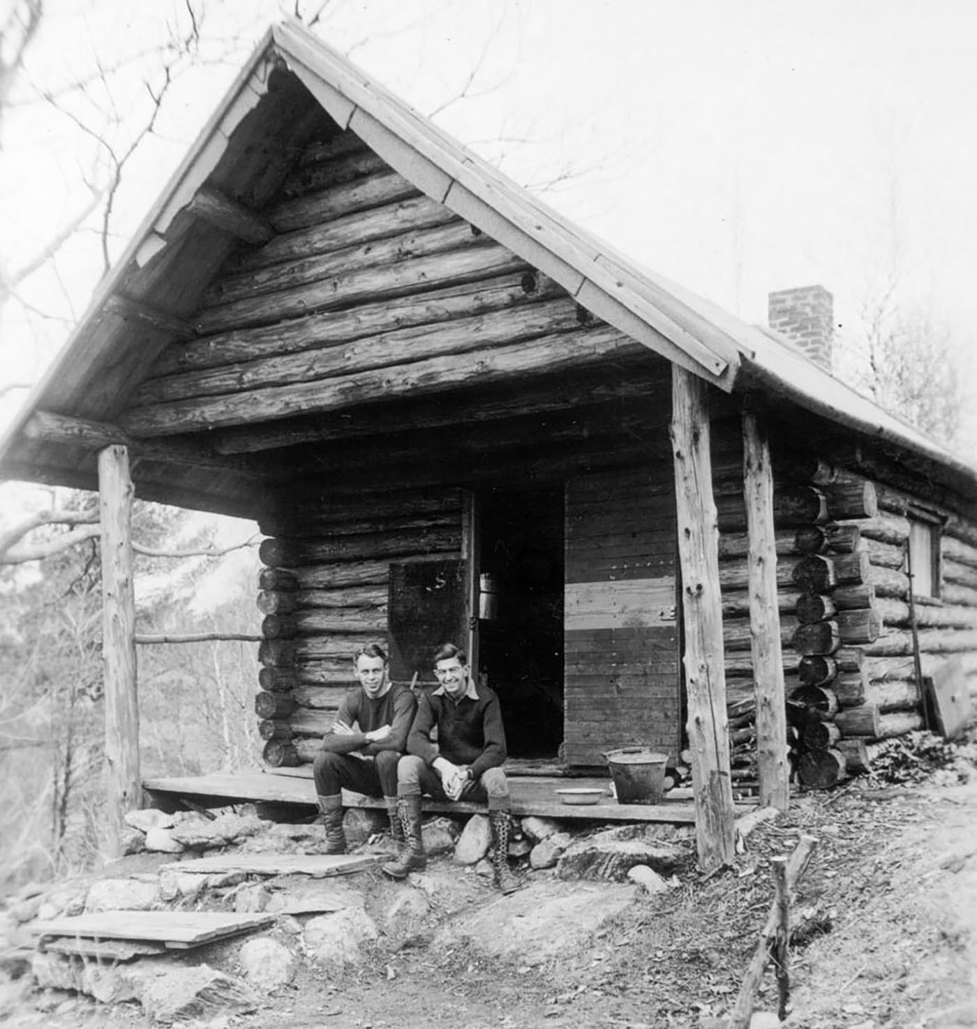 Circa 1934, two students pose outside the Bates Outing Club cabin on Sabattus Mountain in nearby Wales. (Muskie Archives and Special Collections Library)