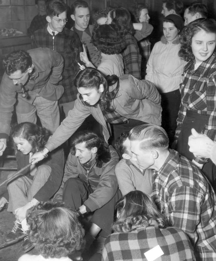 Students enjoy a cabin party at the Stanton Lodge at Thorncrag Nature Sanctuary, circa 1950. (Muskie Archives and Special Collections Library)
