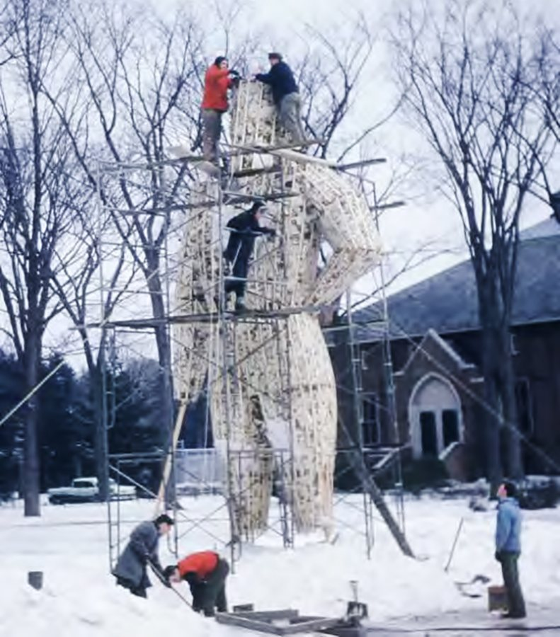 Bates students work on the Bates Outing Club's Paul Bunyan snow sculpture in 1962. (Courtesy of The Legend)