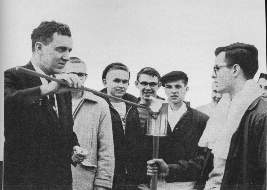 Then-Maine Gov. Edmund Muskie '36 lights a torch to kick off Winter Carnival. (Muskie Archives and Special Collections Library)