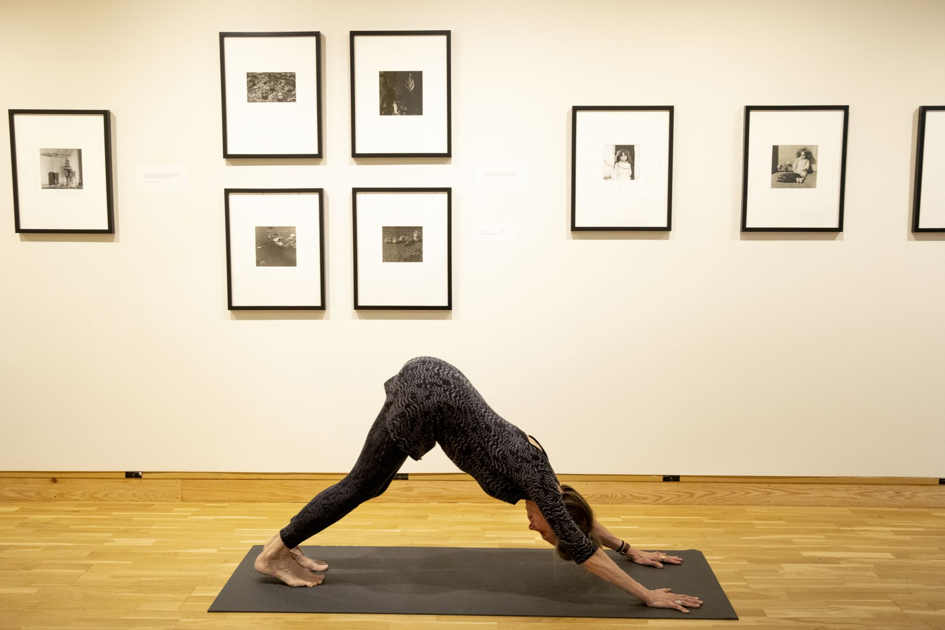 Olin Arts Center Heidi Sawyer teaches midday yoga class for faculty and staff in Museum's lower gallery.